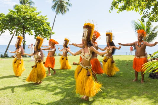 Papeete, French Polynesia - March 01, 2018 : Polynesian women perform traditional dance in Tahiti Papeete, French Polynesia. Polynesian dances are major tourist attraction of luxury resorts of French Polynesia.